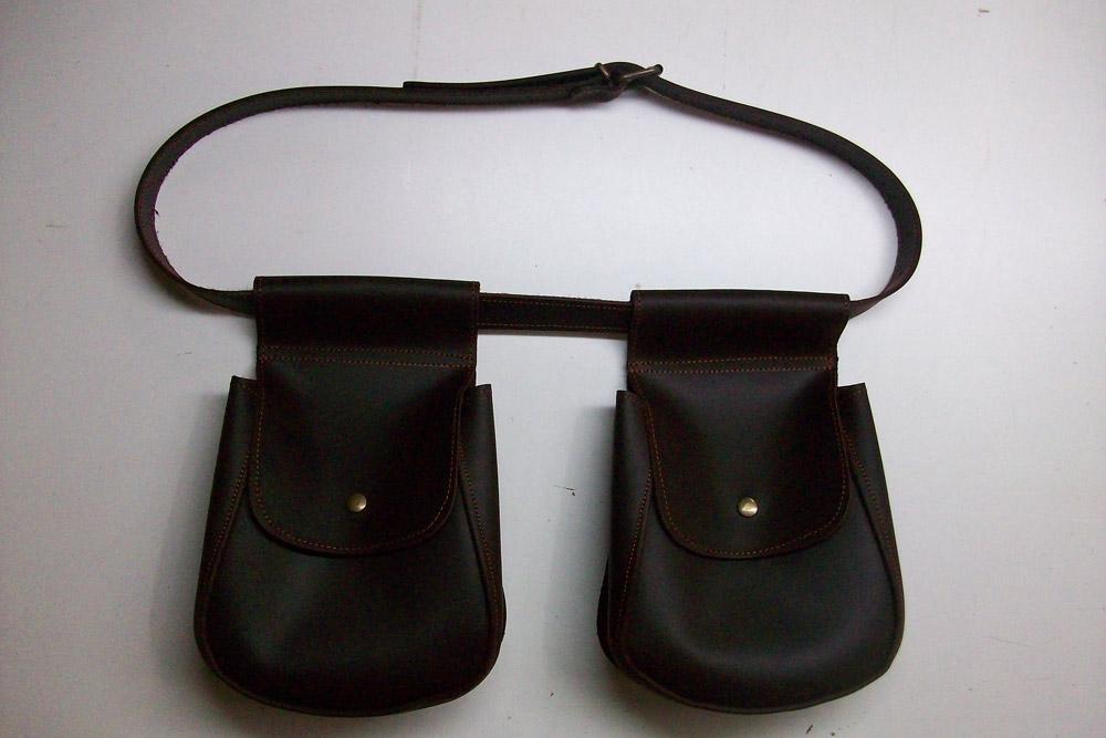 Bolsas de ojeo en piel engrasada con tapa